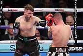 24th March 2018, O2 Arena, London, England; Matchroom Boxing, WBC Silver Heavyweight Title, Dillian Whyte versus Lucas Browne; Lewis Ritson Versus Scott Cardle British Lightweight championship; A focussed Scott Cardle attacks lr early in the first round