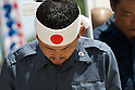 August 15, 2011, Tokyo, Japan - A member of a right-wing group bows his head during a minutes silence during commemorations marking the end of WW2. (Photo by Bruce Meyer-Kenny/AFLO) [3692]