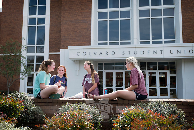 Friends having lunch and chatting outside Colvard Student Union. L-R: Mary Katherine Swindoll (mks438, in light blue), Arielle Striplin (ags324, in grey), Ashlee Clapper (alc948, in maroon), Meghan Norman (man278, light maroon).<br />  (photo by Megan Bean / &copy; Mississippi State University)