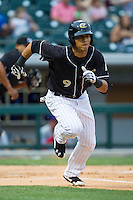 Gorkys Hernandez (9) of the Charlotte Knights hustles down the first base line against the Buffalo Bisons at BB&T Ballpark on May 9, 2014 in Charlotte, North Carolina.  The Knights defeated the Bisons 5-3.  (Brian Westerholt/Four Seam Images)