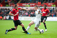 Saturday 17 August 2013<br /> <br /> Pictured: Ben Davies of Swansea takes a challange at <br /> <br /> Re: Barclays Premier League Swansea City v Manchester United at the Liberty Stadium, Swansea, Wales