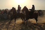 Palestinian Bedouins ride horses during a rally marking the 41st anniversary of Land Day, in Deir el-Balah, Central Gaza Strip, on March 31, 2017.  Land Day marks the killing of six Arab Israelis during 1976 demonstrations against Israeli confiscations of Arab land. Photo by Ashraf Amra