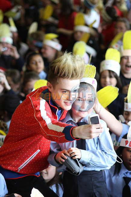 Presentation Primary School in Drogheda receive a visit from Jedward as the prize for collecting the most used mobile phones per student for the Jack and Jill Foundation. ..(Photo credit should read Jenny Matthews www.newsfile.ie)....This Picture has been sent you under the conditions enclosed by:.Newsfile Ltd..The Studio,.Millmount Abbey,.Drogheda,.Co Meath..Ireland..Tel: +353(0)41-9871240.Fax: +353(0)41-9871260.GSM: +353(0)86-2500958.email: pictures@newsfile.ie.www.newsfile.ie.