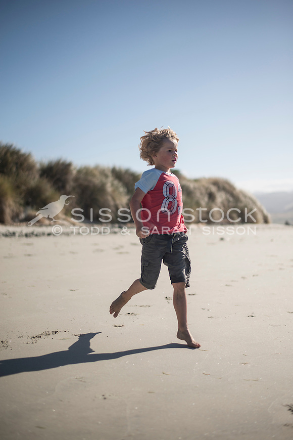 Young boy  at the beach, Dunedin, New Zealand - stock photo, canvas, fine art print