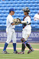 April 12, 2009:  Pitcher Jose De La Torre and Catcher Rafael Arroyo of the St. Lucie Mets, Florida State League Class-A affiliate of the New York Mets, during a game at Tradition Field in St. Lucie, FL.  Photo by:  Mike Janes/Four Seam Images