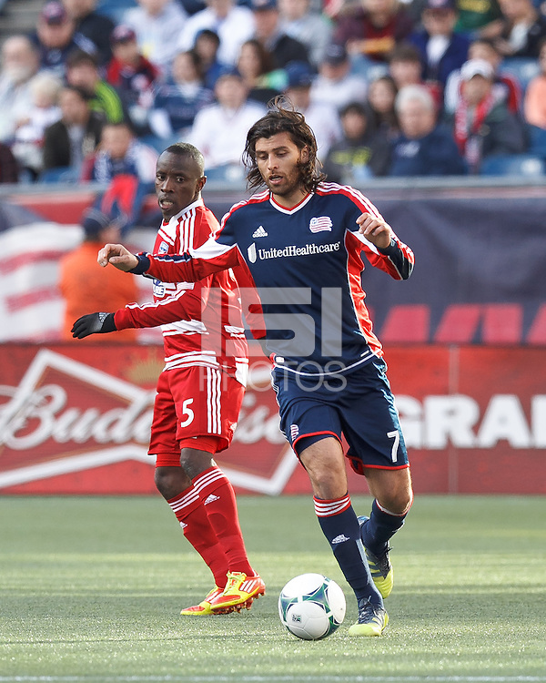 New England Revolution forward Juan Toja (7) controls the ball at midfield. .  In a Major League Soccer (MLS) match, FC Dallas (red) defeated the New England Revolution (blue), 1-0, at Gillette Stadium on March 30, 2013.