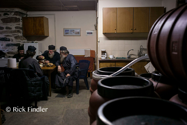 Mount Athos - The Holy Mountain.<br /> Monks sit and talk as they brew their wine.<br /> <br /> Photographer: Rick Findler