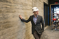 NWA Democrat-Gazette/BEN GOFF @NWABENGOFF<br /> Martin Miller, executive director of TheatreSquared, talks about the boad-formed concrete walls Friday, March 1, 2019, while giving a tour of the new TheatreSquared building under construction in downtown Fayetteville.