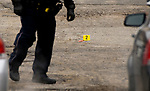 WATERBURY, CT-011518JS10--A Waterbury police walks past tagged shell casings as they investigate a shooting that occurred Tuesday at  the Mallview Condominium on Mark Lane in Waterbury. <br />   Jim Shannon Republican-American