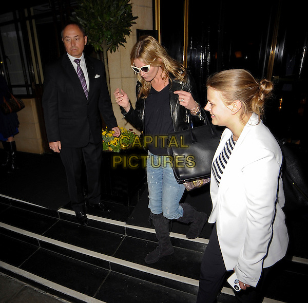 Kate Moss leaving the Dorchester Hotel, London England.<br /> 29th May 2013<br /> full length sunglasses shades black top leather jacket boots jeans denim bag purse<br /> CAP/IA<br /> &copy;Ian Allis/Capital Pictures