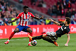 Thomas Teye Partey of Atletico de Madrid (L) fights for the ball with Enric Saborit Teixidor of Athletic Club de Bilbao (R) during the La Liga 2017-18 match between Atletico de Madrid and Athletic de Bilbao at Wanda Metropolitano  on February 18 2018 in Madrid, Spain. Photo by Diego Souto / Power Sport Images