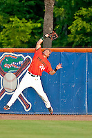 June 11, 2010:   Miami Outfielder Chris Pelaez (22) goes up high to grab a fly ball for an out during game one of NCAA Gainesville Super Regional action between the University of Florida Gators and Miami Hurricanes at Alfred A. McKethan Stadium on the campus of University of Florida in Gainesville.   Florida defeated Miami 7-2 to take a 1-0 lead in the best of three series............