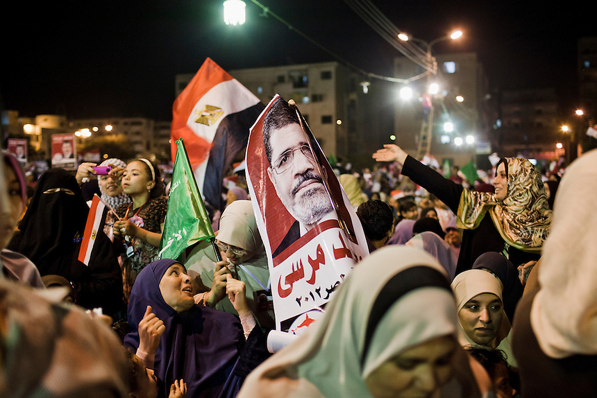A poster for Muslim Brotherhood presidential candidate Dr Mohammed Morsi among a crowd of female supporters at Benha near Cairo, Egypt, May 17, 2012. Photo: ED GILES.