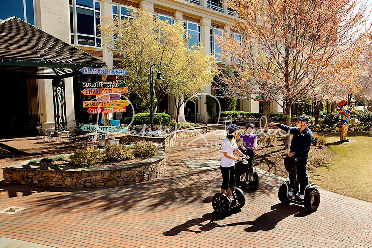 Segway riders explore sculptures in The Green, a 1.5-acre urban park in the heart of Charlotte.
