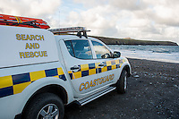 "Friday  29 April 2016<br /> Pictured: A cost guard vehicle at Aberidddi beach <br /> <br /> Re: Two fishermen who went missing after a boat sank in Pembrokeshire went overboard while lobster pots were being thrown into the sea.<br /> Gareth Willington, 59, from Carew, died after his boat The Harvester sank off St David's Head on 28 April.<br /> The body of his son, Daniel, 32, has never been found.<br /> Gareth Willington was not wearing a lifejacket when he was found, a report by the Marine Accident Investigation Branch said.<br /> The investigation found the pair were lobster fishing near Ramsay Island when Daniel Willington may have become entangled in ropes on the deck.<br /> His father may have tried to help him before both men went into the water ""in quick succession"", it said."