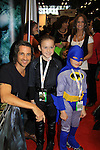 """General Hospital Michael Easton (One Life To Live, Port Charles, Days of Our Lives) with fans at the New York Comic Con 2012 to show fans and others """"Soul Stealer Collector's Edition"""" which he cowrote and  was in a booth with Christopher Shy on October 13, 2012 at the Javits Center, New York City, New York. (Photo by Sue Coflin/Max Photos)"""