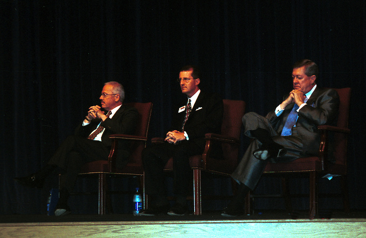 politics080702 -- Republican Reps. Bob Barr (left) and John Linder are separated by Michael Berlon, the Democrat in the race, on stage at a 7th district candidate forum Monday at Norcross High School in Georgia.