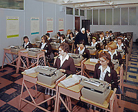 Saint John Villa Academy, NY. Typing classroom with teenage girls & a nun
