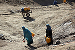 4 APRIL 2012, Kabul, Afghanistan: Women collect water by hand on the outskirts of Kabul, at Qala-e-Fato village.  Picture by Graham Crouch/The Australian