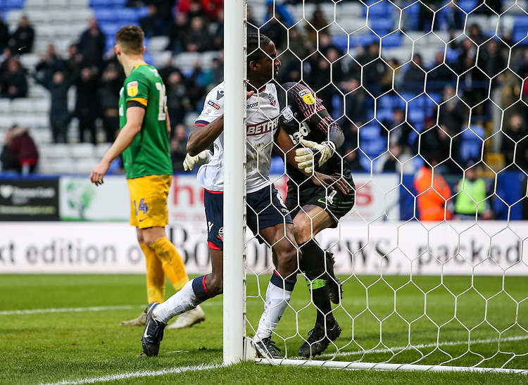 Bolton Wanderers' Clayton Donaldson runs into  Preston North End's goalkeeper Declan Rudd after scoring his side's first goal<br /> <br /> Photographer Andrew Kearns/CameraSport<br /> <br /> The EFL Sky Bet Championship - Bolton Wanderers v Preston North End - Saturday 9th February 2019 - University of Bolton Stadium - Bolton<br /> <br /> World Copyright &copy; 2019 CameraSport. All rights reserved. 43 Linden Ave. Countesthorpe. Leicester. England. LE8 5PG - Tel: +44 (0) 116 277 4147 - admin@camerasport.com - www.camerasport.com