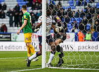 Bolton Wanderers' Clayton Donaldson runs into  Preston North End's goalkeeper Declan Rudd after scoring his side's first goal<br /> <br /> Photographer Andrew Kearns/CameraSport<br /> <br /> The EFL Sky Bet Championship - Bolton Wanderers v Preston North End - Saturday 9th February 2019 - University of Bolton Stadium - Bolton<br /> <br /> World Copyright © 2019 CameraSport. All rights reserved. 43 Linden Ave. Countesthorpe. Leicester. England. LE8 5PG - Tel: +44 (0) 116 277 4147 - admin@camerasport.com - www.camerasport.com