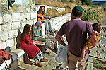 Settler sing and play music as they gather near a fountain (not seen), at the outskirts of the Israeli settlement of Bat A'in, West Bank.