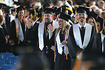 Graduates wave to family and friends as they file in for the 2018 Western Nevada College Commencement ceremony, in Carson City, Nev., on Monday, May 21, 2018. 539 students graduated with 571 degrees including 84 Jump Start students. <br />