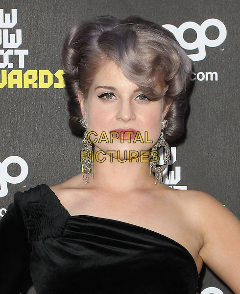 KELLY OSBOURNE.Logo's NewNowNext Awards 2010 held at The Edison, Los Angeles, CA, USA..June 8th, 2010.headshot portrait black one shoulder dangling silver diamond earrings purple tinted dyed hair flick eyeliner make-up beauty .CAP/ADM/KB.©Kevan Brooks/AdMedia/Capital Pictures.