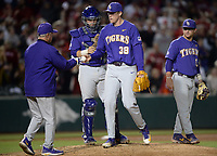 NWA Democrat-Gazette/ANDY SHUPE<br /> LSU coach Paul Mainieri collects the ball from reliever Zack Hess Friday, May 10, 2019, after Hess gave up 2 runs during the seventh inning against Arkansas at Baum-Walker Stadium in Fayetteville. Visit nwadg.com/photos to see more photographs from the game.