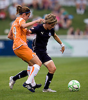 Washington Freedom midfielder (8) Sonia Bompastor shields the ball away from  Sky Blue FC midfielder (9) Heather O'Reilly at the Maryland SoccerPlex in Boyds, Maryland.  The Washington Freedom defeated Sky Blue FC, 3-1, to secure a place in the playoffs.