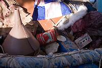 Cimitero delle barche...I barconi che trasportano i profughi vengono depositati in tre punti dell isola in attesa di essere smaltiti. ..Vari oggetti sparsi vicino alle barche depositate nei pressi del porto...Lampedusa 05 Marzo 2011...Photo Serena Cremaschi Insidefoto..........