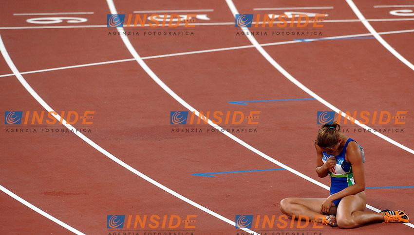 Lucimara Silva of Brazil after her 800m of Heptathlon<br /> La brasiliana Lucimara Silva a terra si fa il segno della croce dopo la prova conclusiva dell'Heptathlon<br /> National Stadium - Bird Nest<br /> Pechino - Beijing 16/8/2008 Olimpiadi 2008 Olympic Games<br /> Foto Andrea Staccioli Insidefoto