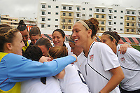 The USWNT shares a light moment in the pre-game huddle. The USA defeated Norway 2-1 at Olhao Stadium on February 26, 2010 at the Algarve Cup.
