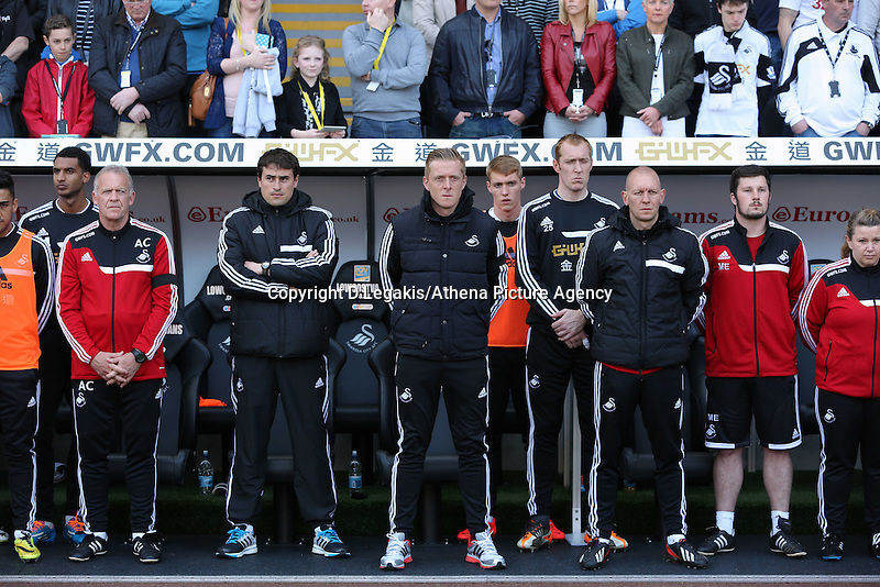 Sunday, 13 April 2014<br /> Pictured L-R: Swansea coaching staff, Alan Curtis, Pep, Garry Monk and Adrian Tucker observe a minute's silence before kick off.<br /> Re: Barclay's Premier League, Swansea City FC v Chelsea at the Liberty Stadium, south Wales,