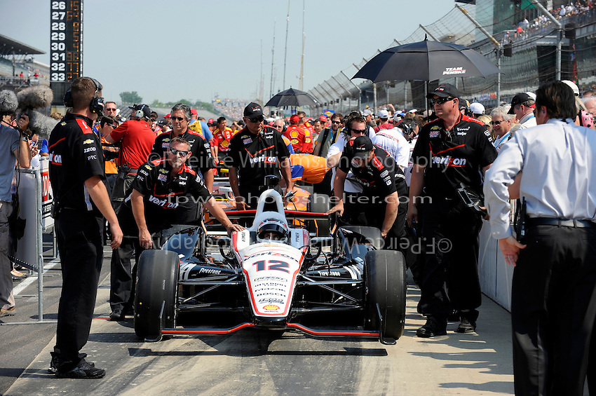 Will Power (#12) is pushed through the qualifying line.