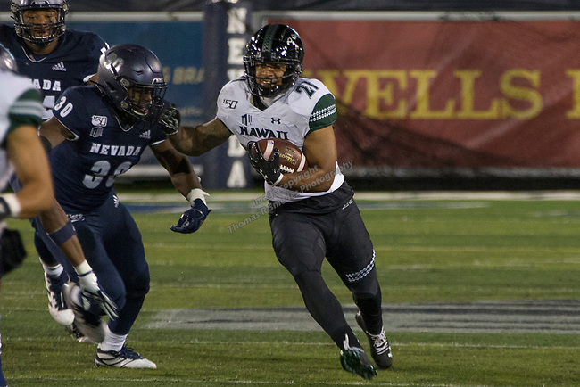 Hawaii running back Fred Holly III runs against Nevada in the first half of an NCAA college football game in Reno, Nev. Saturday, Sept. 28, 2019. (AP Photo/Tom R. Smedes)