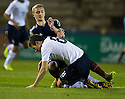 Scotland's Sean McKirdy and England's Herbie Kane challenge for the ball.