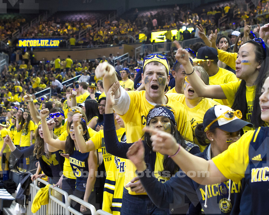 Friends and fans of the University of Michigan men's basketball team watch the NCAA Basketball Championship during a viewing party at Crisler Center in Ann Arbor, Mich., on April 8, 2013.