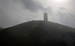 Contre jour view of St Michael's Tower on Glastonbury Tor, Somerset, England