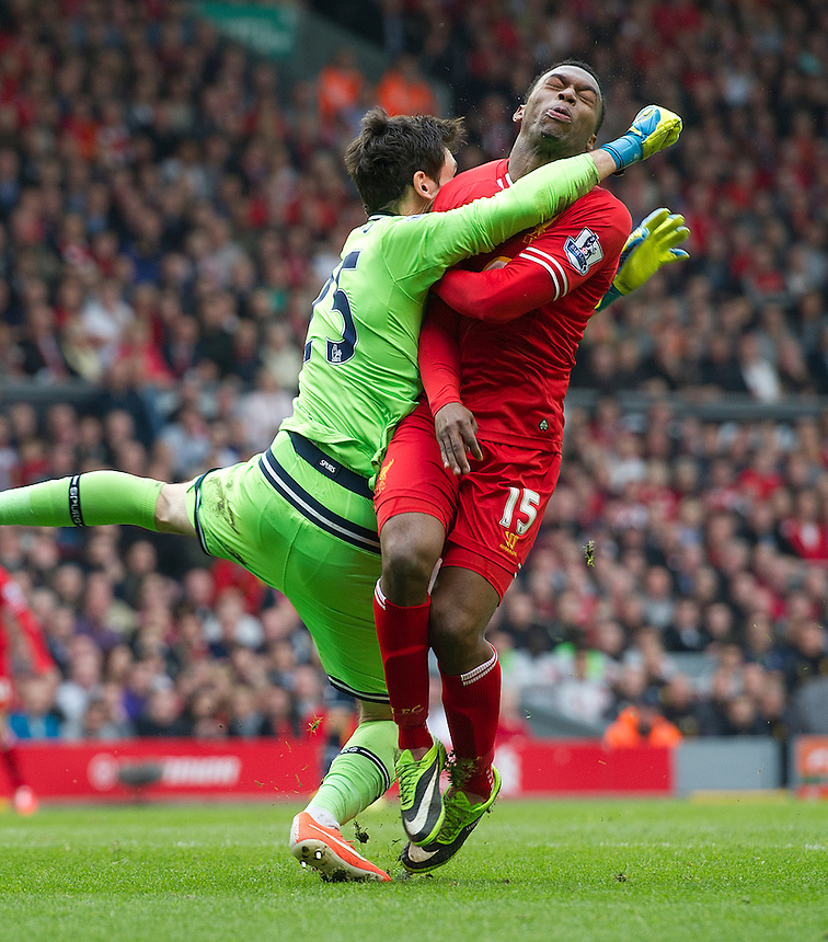 Tottenham Hotspur's goalkeeper Hugo Lloris collides with Liverpool's Daniel Sturridge<br /> <br /> Photo by Stephen White/CameraSport<br /> <br /> Football - Barclays Premiership - Liverpool v Tottenham Hotspur	 - Sunday 30th March 2014 - Anfield - Liverpool<br /> <br /> &copy; CameraSport - 43 Linden Ave. Countesthorpe. Leicester. England. LE8 5PG - Tel: +44 (0) 116 277 4147 - admin@camerasport.com - www.camerasport.com