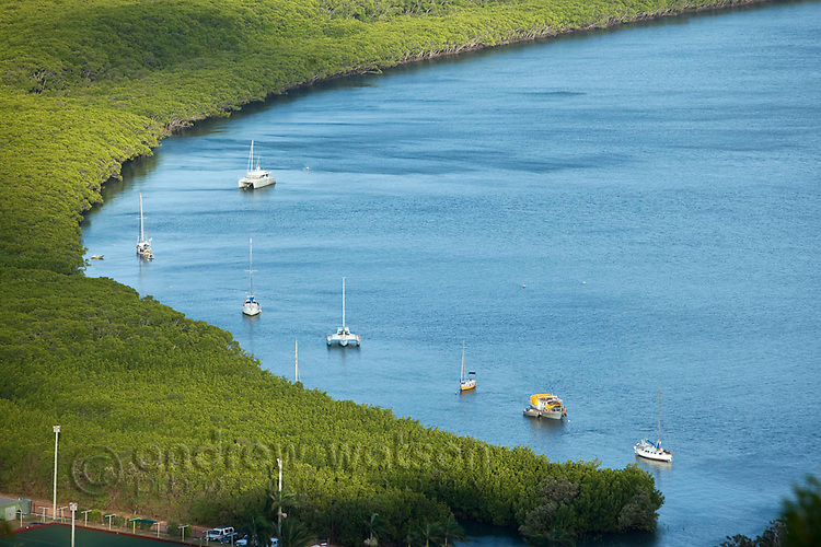 Boats moored in the Endeavour River.  Cooktown, Queensland, Australia