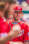 27 July 2013: Washington Nationals pitcher Stephen Strasburg smiles in the dugout during a game against the New York Mets at Nationals Park in Washington, DC. The Nationals defeated the Mets 4-1. Mandatory Credit: Ed Wolfstein Photo *** RAW (NEF) Image File Available ***