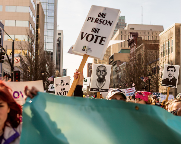 February 11, 2017. Raleigh, North Carolina.<br /> <br /> HKONJ marchers held posters depicting James Chaney and Andrew Goodman, civil rights workers who were murdered during Freedom Summer by members of the Ku Klux Klan in Mississippi.<br /> <br /> Thousands gathered in downtown Raleigh for the annual HKONJ People's Assembly, a civil rights march tied to the Moral Monday movement. Supporters from around the state gathered to march and speak out against nationwide attacks on civil rights and the Trump administration.<br /> <br /> Jeremy M. Lange for The New York Times