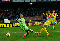 Gokhan Inler  shoots to score past  Michel Vorm <br /> <br />  UEFA Europa League round of 32 second  leg match, betweenAC  Napoli  and Swansea City   at San Paolo stadium in Naples, Feburary 27 , 2014  <br /> gol