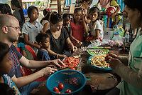 05/04/2013 - Siem Reap (Cambodia). Volunteer prepare food for the kids in a orphanage in the outskirt of Siem Reap. Despite the good intentions, most short-term volunteers lack experience in dealing with institutionalised children. © Thomas Cristofoletti 2013