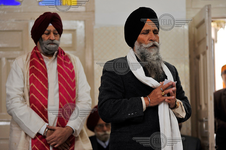 The father of the groom and the ceremony priest at the wedding of British/Punjabi couple Lindsay and Navneet Singh.