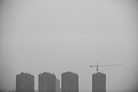 Daytime landscape view from the Xī'ān chéngqiáng of commercial buildings under construction in the Xī'ān Shì Weiyang District in Shaanxi Province.  © LAN