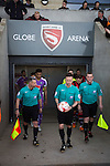 Referee David Webb leading out the teams at the Globe Arena before Morecambe (in red stripes) hosted Plymouth Argyle in a League 2 fixture. The stadium was opened in 2010 and replaced Morecambe's traditional home of Christie Park which had been their home since 1921, the year after their foundation. Plymouth won this fixture by 2-0 watched by 2,081 spectators, in a game delayed by 30 minutes due to traffic congestion affecting travelling Argyle fans.
