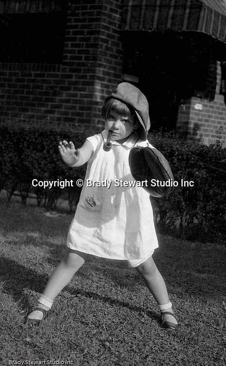 Wilkinsburg PA: Sally Stewart playing baseball in the backyard with her brother Brady - 1928.  Playing in the front yard of their 1007 East End Avenue house.