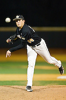 Max Tishman (34) of the Wake Forest Demon Deacons delivers a pitch to the plate against the West Virginia Mountaineers at Wake Forest Baseball Park on February 24, 2013 in Winston-Salem, North Carolina.  The Demon Deacons defeated the Mountaineers 11-3.  (Brian Westerholt/Four Seam Images)